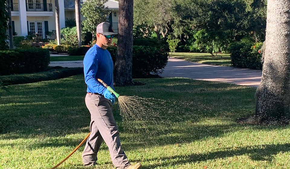 Spraying a lawn with fertilizer treatments in Siesta Key, Florida.