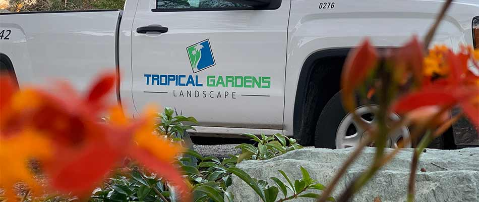 Tropical Gardens Landscape work truck at a property in Siesta Key, Florida.