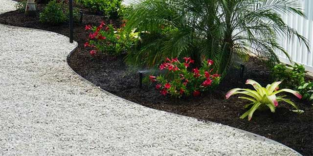 Rock mulch installed at a property in Longboat Key, Florida.
