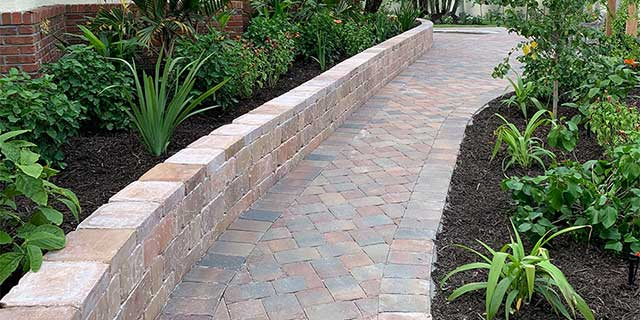 Brick pavers and retaining wall installed at a home in Sarasota, Florida.